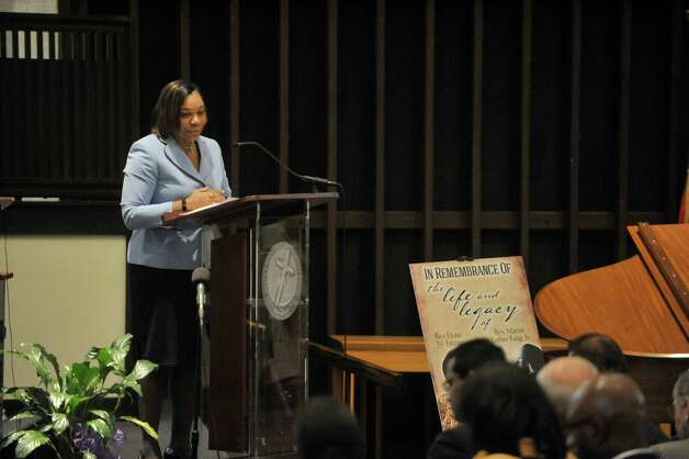 Angelicia Morris, executive director of the Schenectady County Human Rights Commission, addresses those gathered at Mt. Olivet Baptist Church during a Martin Luther King, Jr. Celebration on Sunday, Jan. 18, 2015, in Schenectady, N.Y.  This year's event was dedicated in remembrance of Rev. Eloise Frazier, the founder of the Schenectady County Human Rights CommissionOs Martin Luther King,Jr. Coalition.  Rev. Frazier passed away in October.  (Paul Buckowski / Times Union) Photo: Paul Buckowski / 00030152A