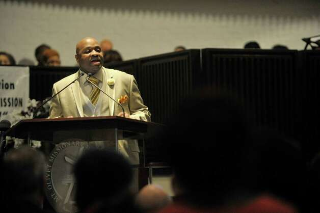 Rev. Horace Sanders, pastor at Mt. Olivet Baptist Church, addresses those gathered during a Martin Luther King, Jr. Celebration at his church on Sunday, Jan. 18, 2015, in Schenectady, N.Y.  This year's event was dedicated in remembrance of Rev. Eloise Frazier, the founder of the Schenectady County Human Rights CommissionOs Martin Luther King,Jr. Coalition.  Rev. Frazier passed away in October.  (Paul Buckowski / Times Union) Photo: Paul Buckowski / 00030152A