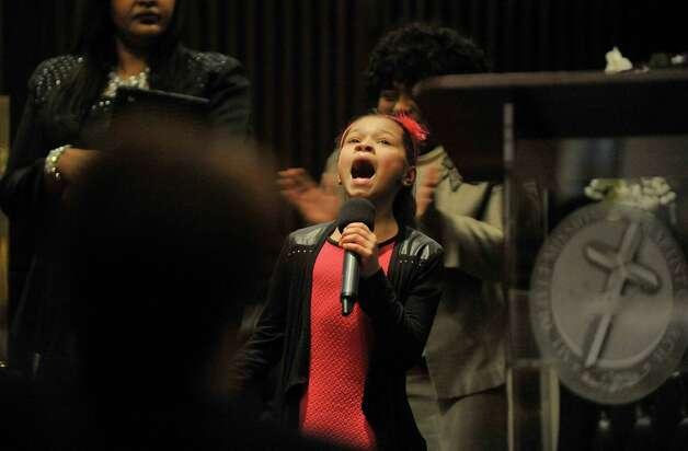 """Jada Chance, 9, of Schenectady sings """"Can't Give Up Now"""" at the Mt. Olivet Baptist Church during a Martin Luther King, Jr. Celebration on Sunday, Jan. 18, 2015, in Schenectady, N.Y.  This year's event was dedicated in remembrance of Rev. Eloise Frazier, the founder of the Schenectady County Human Rights CommissionOs Martin Luther King,Jr. Coalition.  Rev. Frazier passed away in October.  (Paul Buckowski / Times Union) Photo: Paul Buckowski / 00030152A"""