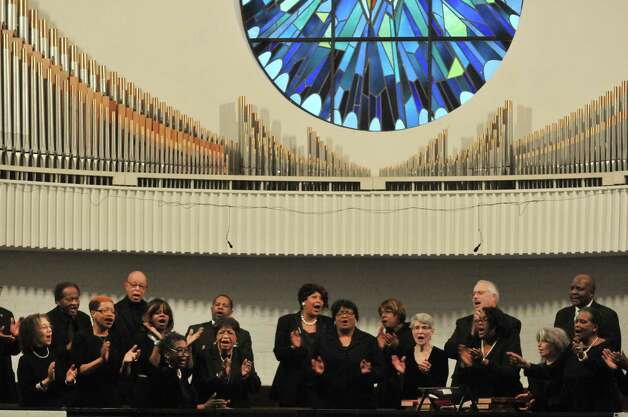 Members of the Martin Luther King Community Choir perform at Mt. Olivet Baptist Church during a Martin Luther King, Jr. Celebration on Sunday, Jan. 18, 2015, in Schenectady, N.Y.  This year's event was dedicated in remembrance of Rev. Eloise Frazier, the founder of the Schenectady County Human Rights CommissionOs Martin Luther King,Jr. Coalition.  Rev. Frazier passed away in October.  (Paul Buckowski / Times Union) Photo: Paul Buckowski / 00030152A