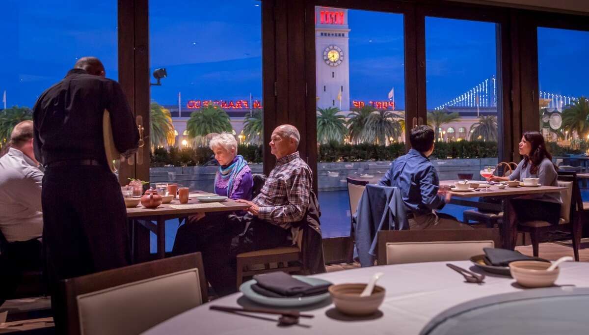 FILE-- Diners have dinner at Crystal Jade in San Francisco on Friday, Jan. 9, 2015.