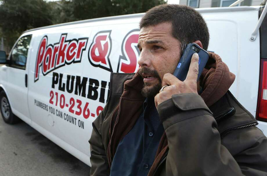 Anthony Cartagena, who's now a plumber with Parker & sons Plumbing, calls in to the office after completing a job at a client's home. A master plumber, Cartagena learned the craft from his father-in-law, instead of following his own father into a life of street crime. Photo: Photos By Bob Owen /San Antonio Express-News / © 2014 San Antonio Express-News