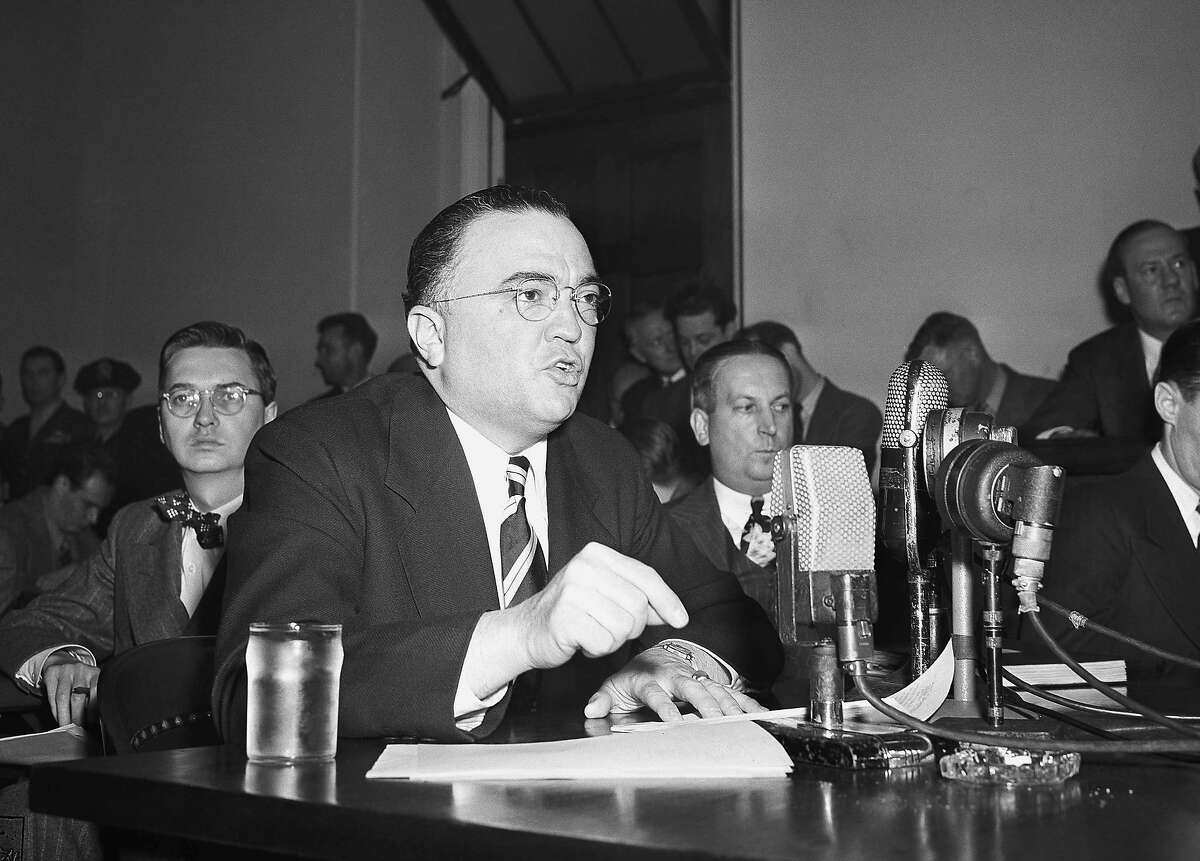 """FILE - This March 26, 1947, file photo shows Federal Bureau of Investigation Director J. Edgar Hoover calling the communist party of the United States a """"Fifth Column"""" whose """"goal is the overthrow of our government"""" during testimony before the House Un-American Activities Committee in Washington."""