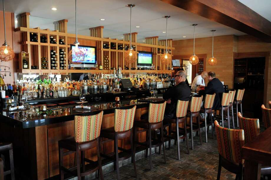 The Bistro Latino, had a warm bar at 1392 East Putnam Avenue, in Old Greenwich, Conn., Tuesday, April 8, 2013. The restaurant recently closed, and is expected to re-oped as Lugano in the spring. Photo: Helen Neafsey / Greenwich Time