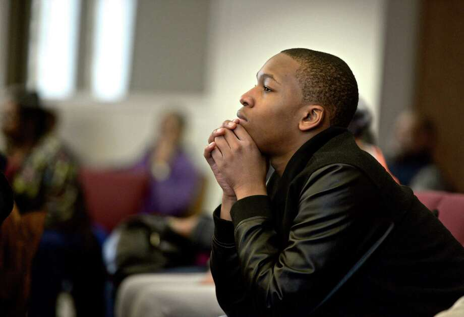 James McCullers, 12, of Danbury, listens to the featured speaker, Devin Mack, during the annual celebration to honor Dr. Martin Luther King Jr, at the New Hope Baptist Church, on Monday, January 19, 2015, in Danbury, Conn. Photo: H John Voorhees III / The News-Times