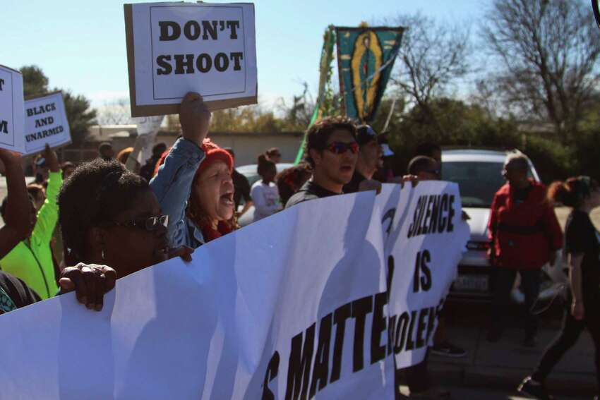 Many attendees at Monday's Martin Luther King Jr. March wore shirts that referenced several controversial cases where white police officers have killed black citizens.