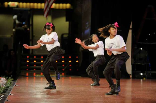 Members of the Tone Setters Step Team from Albany perform during the Dr. Martin Luther King, Jr. Holiday Memorial Observance at the Empire State Plaza Convention Center on Monday, Jan. 19, 2015, in Albany, N.Y.   (Paul Buckowski / Times Union) Photo: Paul Buckowski / 00030151A