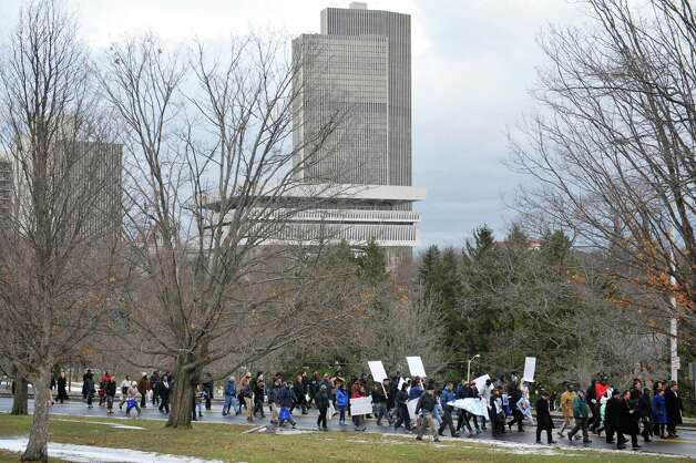 People take part in the Community March to the King Memorial following  the Dr. Martin Luther King, Jr. Holiday Memorial Observance at the Empire State Plaza Convention Center on Monday, Jan. 19, 2015, in Albany, N.Y.   (Paul Buckowski / Times Union) Photo: Paul Buckowski / 00030151A