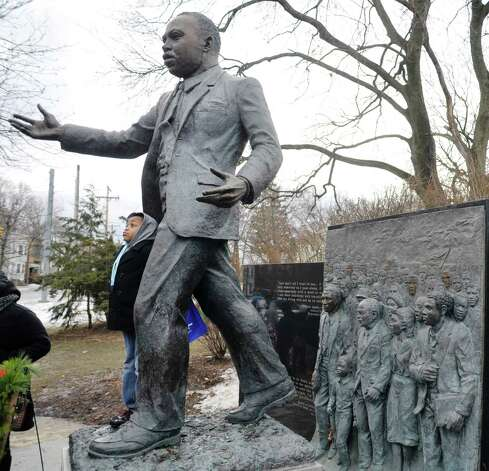 Isaiah Hermitt, 6, of Albany climbs up onto the base of the statue at the King Monument in Lincoln Park following the Dr. Martin Luther King, Jr. Holiday Memorial Observance at the Empire State Plaza Convention Center on Monday, Jan. 19, 2015, in Albany, N.Y.   (Paul Buckowski / Times Union) Photo: Paul Buckowski / 00030151A