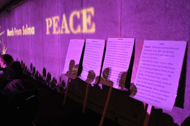 Words were projected onto the walls at the Dr. Martin Luther King, Jr. Holiday Memorial Observance at the Empire State Plaza Convention Center on Monday, Jan. 19, 2015, in Albany, N.Y.   (Paul Buckowski / Times Union) Photo: Paul Buckowski / 00030151A