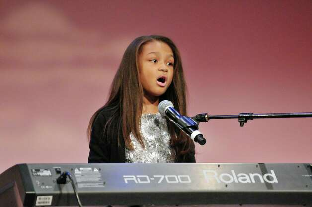 """Nyasha Elon Jones, 10, a student at Mater Christi School in Albany, performs """"Superwoman"""" at the Dr. Martin Luther King, Jr. Holiday Memorial Observance at the Empire State Plaza Convention Center on Monday, Jan. 19, 2015, in Albany, N.Y.   (Paul Buckowski / Times Union) Photo: Paul Buckowski / 00030151A"""
