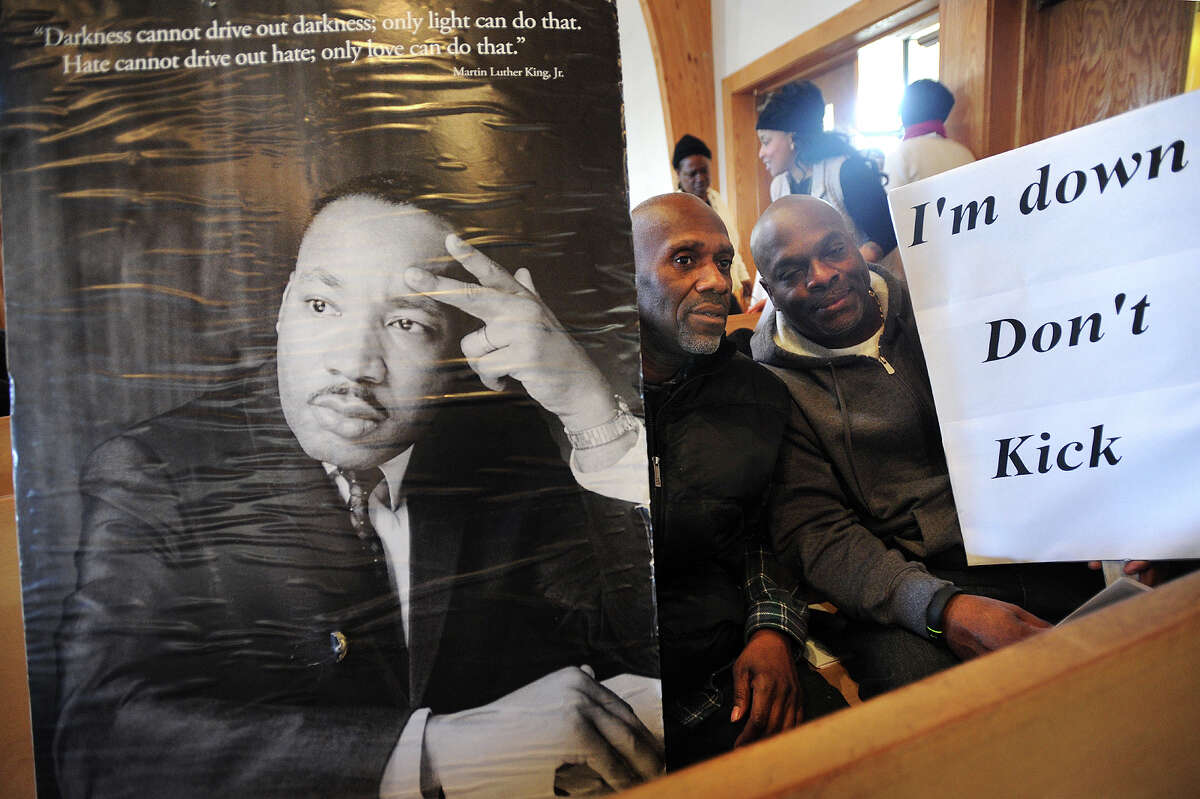 Melvin Johnson, left, and Jimmy Bennett, both of Bridgeport, attend the annual Martin Luther King, Jr. Day service and ceremony at St. Paul Missionary Baptist Church on Logan Street in Bridgeport, Conn. on Monday, January 19, 2015.