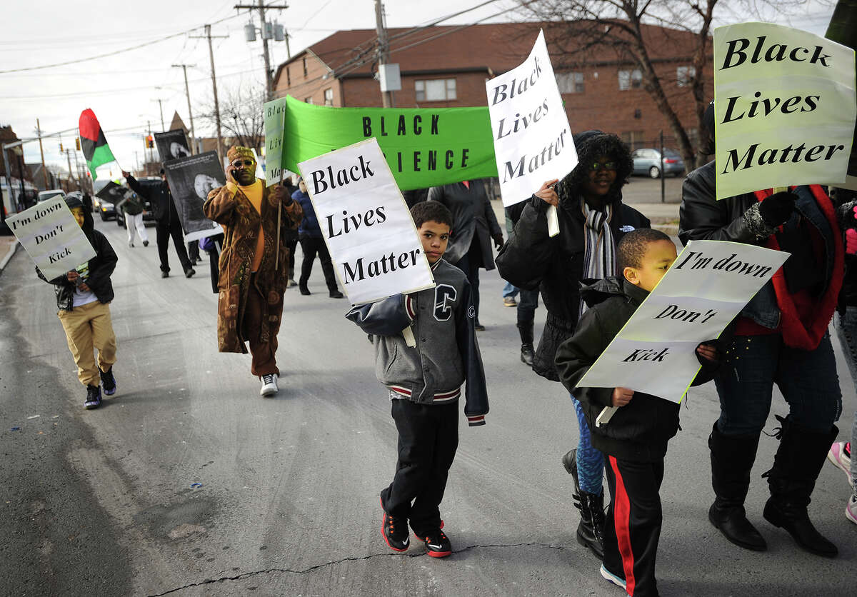The annual Martin Luther King, Jr. Day march proceeds down Stratford Avenue in Bridgeport, Conn. on Monday, January 19, 2015.