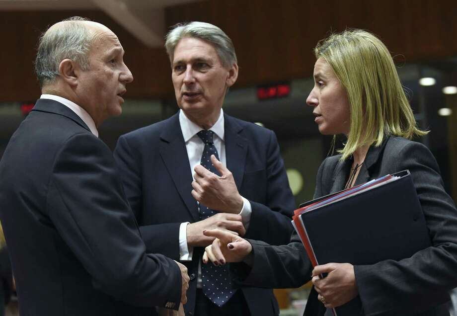 French Foreign Affairs Minister Laurent Fabius (left) talks with British Foreign Secretary Philip Hammond and European Union foreign policy chief Federica Mogherini during a meeting at EU headquarters in Brussels. EU ministers are trying to boost antiterror cooperation in the wake of the Paris attacks and the dismantling of a jihadist cell in Belgium. Photo: JOHN THYS / AFP / Getty Images / AFP