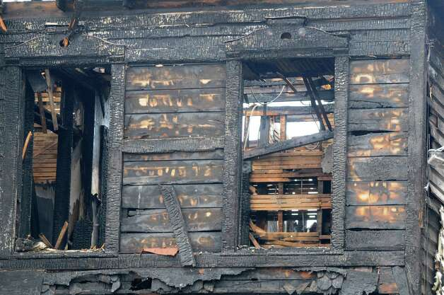 The charred remains of 809 Second Ave., Monday, Jan. 19, 2015, which was set ablaze early Sunday morning in north Troy, N.Y. The city is creating an arson task force and boosting patrols after another fire in a vacant Lansingburgh building stoked fears that a serial arsonist is on the loose. (Will Waldron/Times Union) Photo: WW