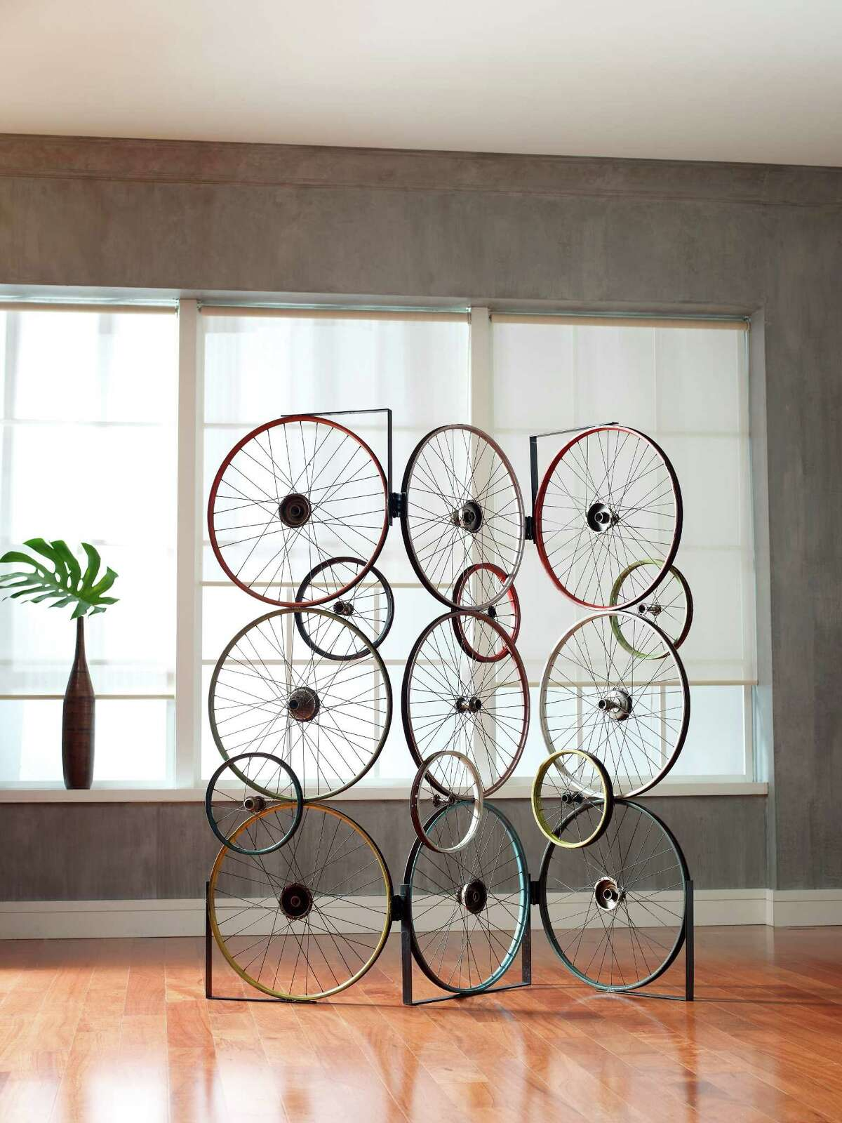 The Bicycle Collection was created by upcycling discarded bicycle rims, pedals and frames. The Bicycle Screen is made from three panels that are hinged together, allowing for many configurations.
