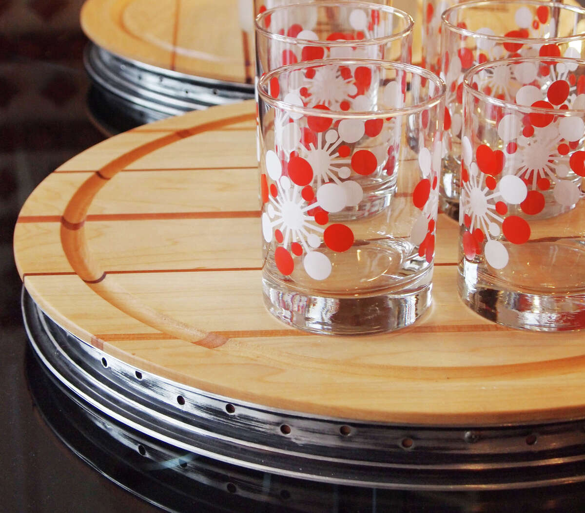 This photo provided by SOLO Home Design shows hip cutting boards from Solo Home Design created with bicycle rims and salvaged wood. (AP Photo/SOLO Home Design)