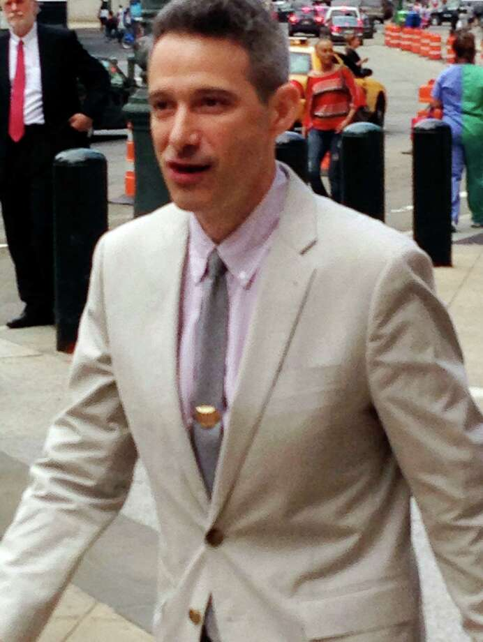 """FILE - In this May 27, 2014 file photo, Beastie Boys rapper Adam """"Ad-Rock"""" Horovitz leaves federal court in Manhattan after testifying at a copyright trial stemming from a lawsuit the group brought against a beverage maker over the use of five of its songs in a video, in New York. The Beastie Boys want to force the maker of Monster Energy drink to pay nearly $2.4 million in legal fees and costs so the rappers' $1.7 million jury award is not dwarfed by expenses in a copyright violation case, lawyers say. A Manhattan federal court jury awarded the group most of the $2 million it requested at a 2014 trial, but that was not enough to cover costs that lawyers said were worsened by the actions of the Corona, California-based Monster Energy Co., the musicians' lawyers said in papers filed in Manhattan federal court. (AP Photo/Larry Neumeister, File) Photo: Larry Neumeister / Associated Press / AP"""
