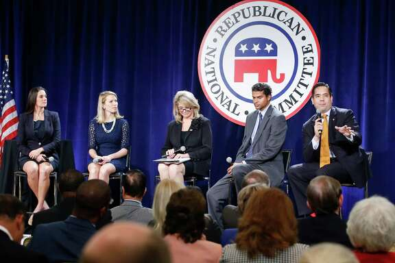 "Attendees of the Republican National Committee winter in San Diego. only about 10 miles from the U.S.-Mexico border, competed with one another over who was the most opposed to illegal immigration. Here Sean Reyes, right, the attorney general for the state of Utah, speaks to a panel designated as ""rising stars."""