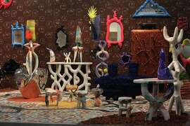 Friedman Benda (New York) featured Misha Kahn's surrealist installation, which included the artist's hand-painted tile floor and furniture. The exhibit is set against a Spaghetti Western wallpaper backdrop and tile floor, also designed by Kahn.