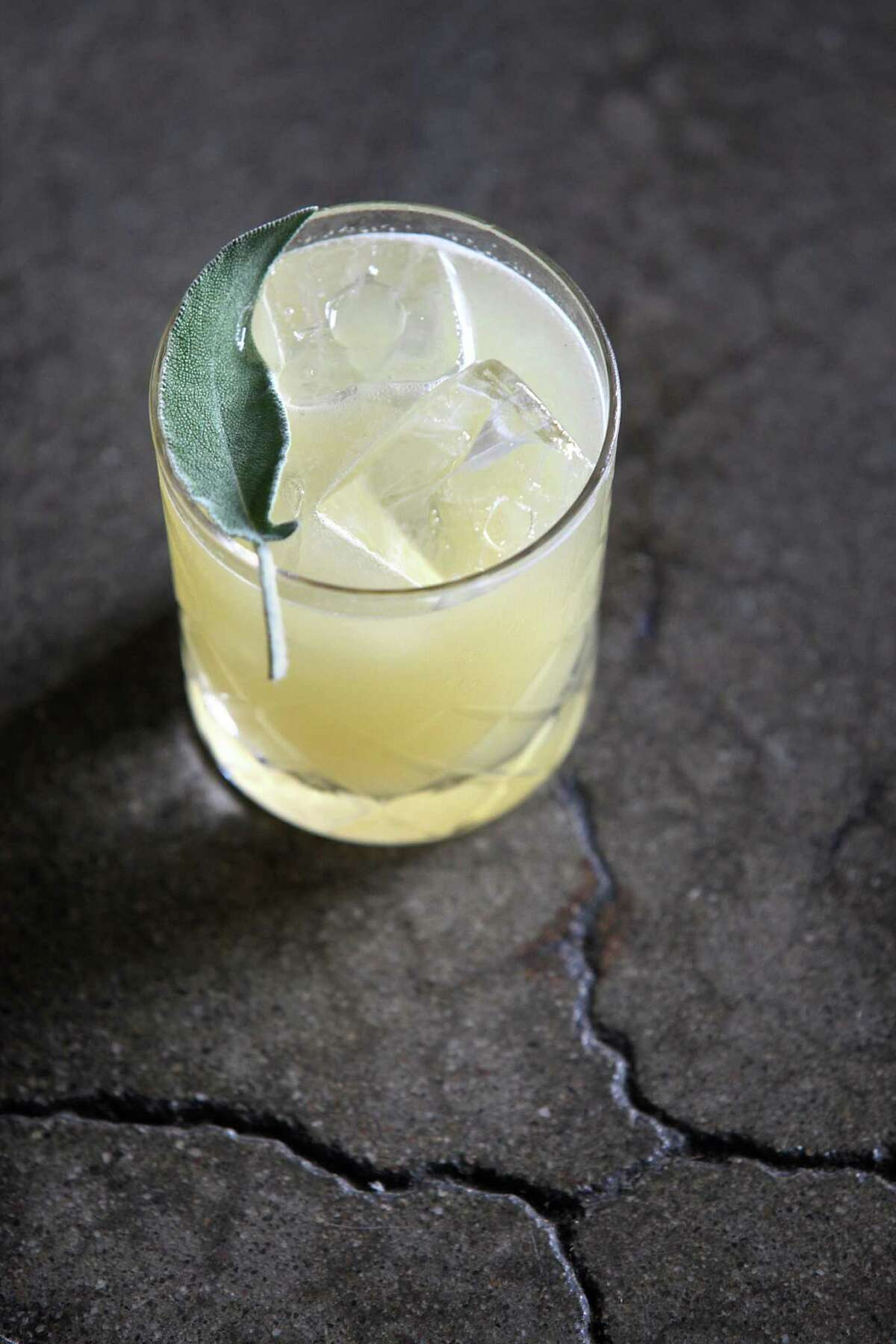 The Old Golden--drink made with mescal, lemon, honey, ginger, and sage-- made and devised by Chris Lane at Ramen Shop in Oakland.