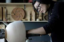 Silvia Song turns a bowl on the lathe in her studio in El Cerrito.