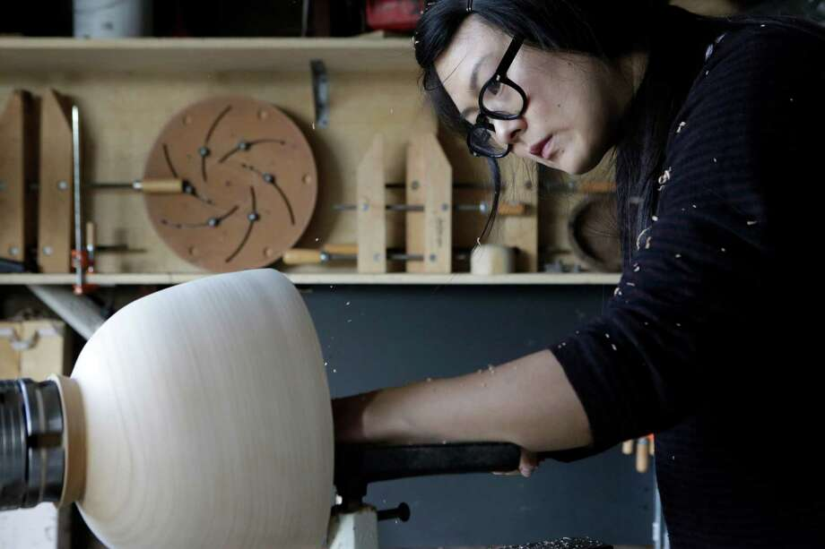 Silvia Song turns a bowl on the lathe in her studio in El Cerrito. Photo: Terray Sylvester / The Chronicle / ONLINE_YES