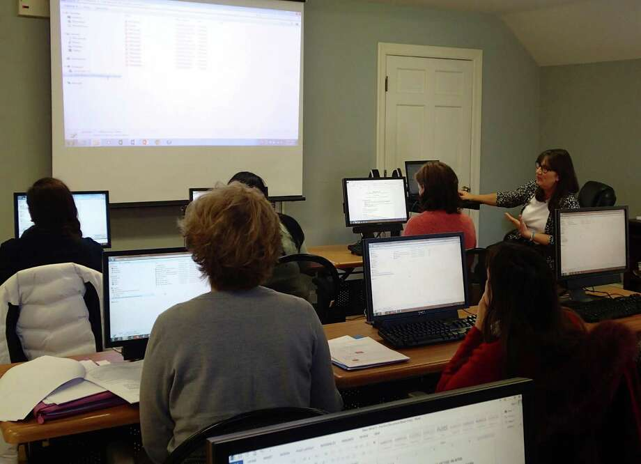 YWCA Darien/Norwalk's Job Search Support Program coordinator Kate Foster instructs a recent class in Microsoft Word at the YW Computer Center. The next session of classes in Word, Excel, PowerPoint, and Publisher begins January 27 at the YW at 49 Old King's Highway North in Darien and is open to all women. To register or to find out more email Kate Foster at katef@ywcadariennorwalk.org or call (203) 655-2535. Photo: Contributed Photo / Greenwich Time Contributed