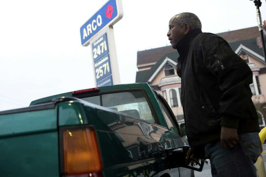 Tsegni Berhe of San Francisco fills up his truck at the Arco station on Divisadero Street on Friday. Photo: Tim Hussin / Special To The Chronicle / ONLINE_YES