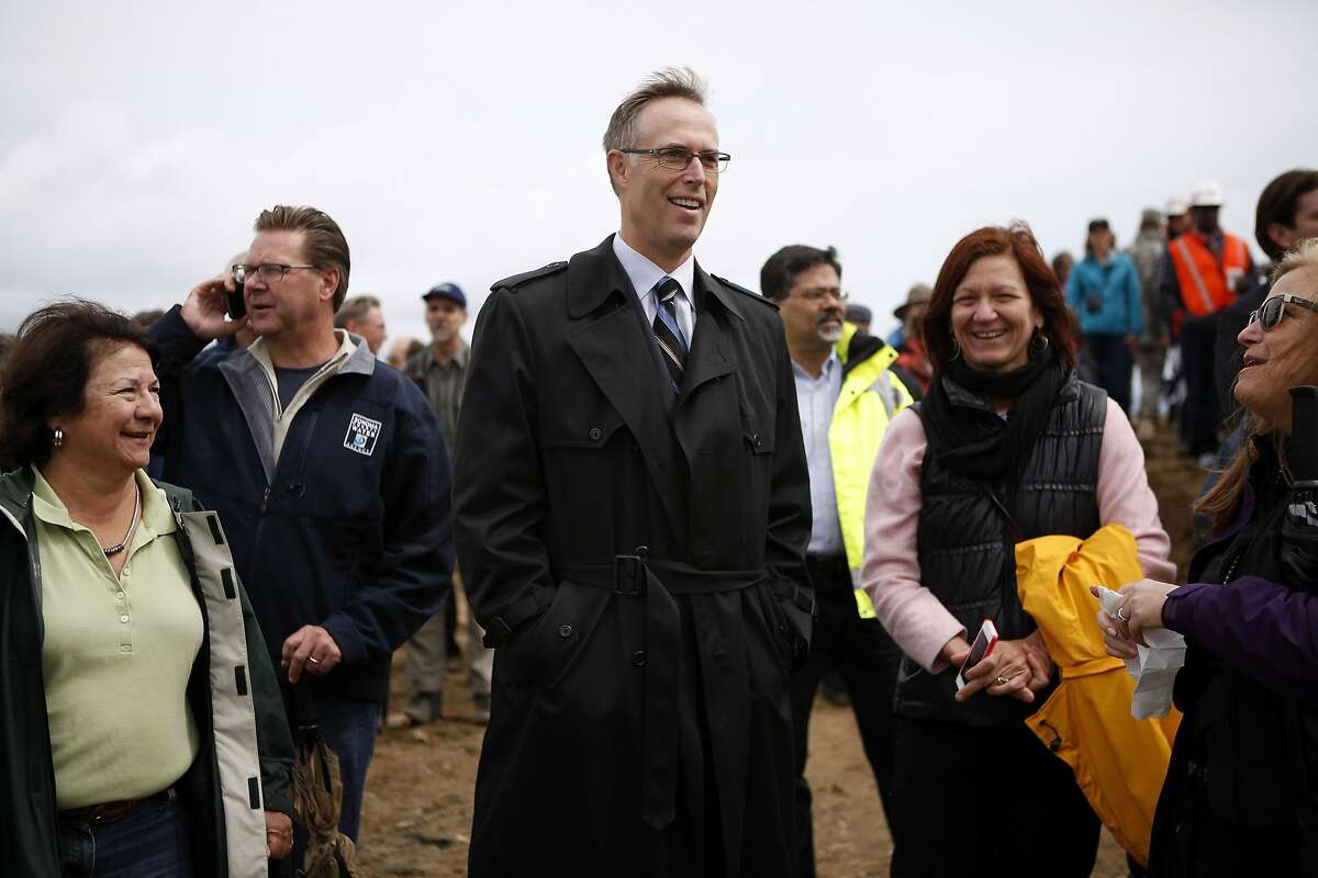 Congressman Jared Huffman watches with others during the levee breaching event at Hamilton Army Airfield in Novato, CA, Friday April 25, 2014. The California State Coastal Conservancy and the U.S. Army Corps of Engineer breeched a levee opening 648 acres of unused land on the Hamilton Army Airfield to San Francisco Bay waters in an ongoing wetlands restoration project.
