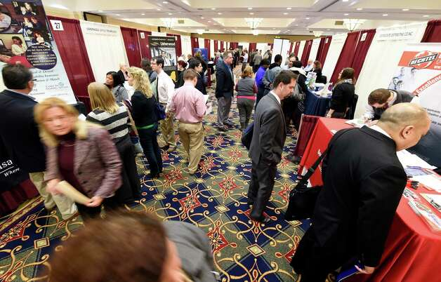 A large crowd turned out for the Times Union Job Fair Monday morning Jan. 19, 2015 at the Albany Marriott Hotel in Colonie, N.Y. (Skip Dickstein/Times Union) Photo: SKIP DICKSTEIN / 00030245A