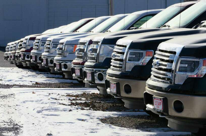 In this Jan. 13, 2015 photo, Ford F-150 pickup trucks are lined up at the Lee Sapp Ford dealership i