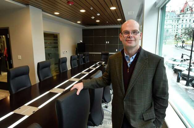 Anders M. Tomson, bank president, stands in the 5th floor conference room of the new Capital Bank building Monday morning Jan. 19, 2015, at 132 State Street in Albany, N.Y.     (Skip Dickstein/Times Union) Photo: SKIP DICKSTEIN / 00030253A