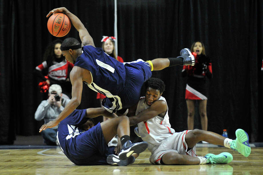 Hillhouse's Dontell Glover Jr(1) trips over his teammate Troy Walters Jr and Central's Quinton Ballew during their Martin Luther King Classic basketball game at Webster Bank Arena in Bridgeport, Conn., on Monday, Jan. 19, 2015. Hillhouse won, 68-51. Photo: Jason Rearick / Stamford Advocate