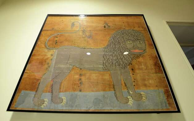 "The ""Poestenkill Lion,"" a folk art painting found in Postenkill which is now displayed at the Rensselaer County Historical Society Monday morning, Jan. 19, 2015, in Troy, N.Y. The painting was donated in 2011 by Hughes and Eva Gemmill, a yearlong, $2,500 conservation effort has made the painting from circa 1840 ready for public viewing. (Will Waldron/Times Union) Photo: WW / 00030220A"