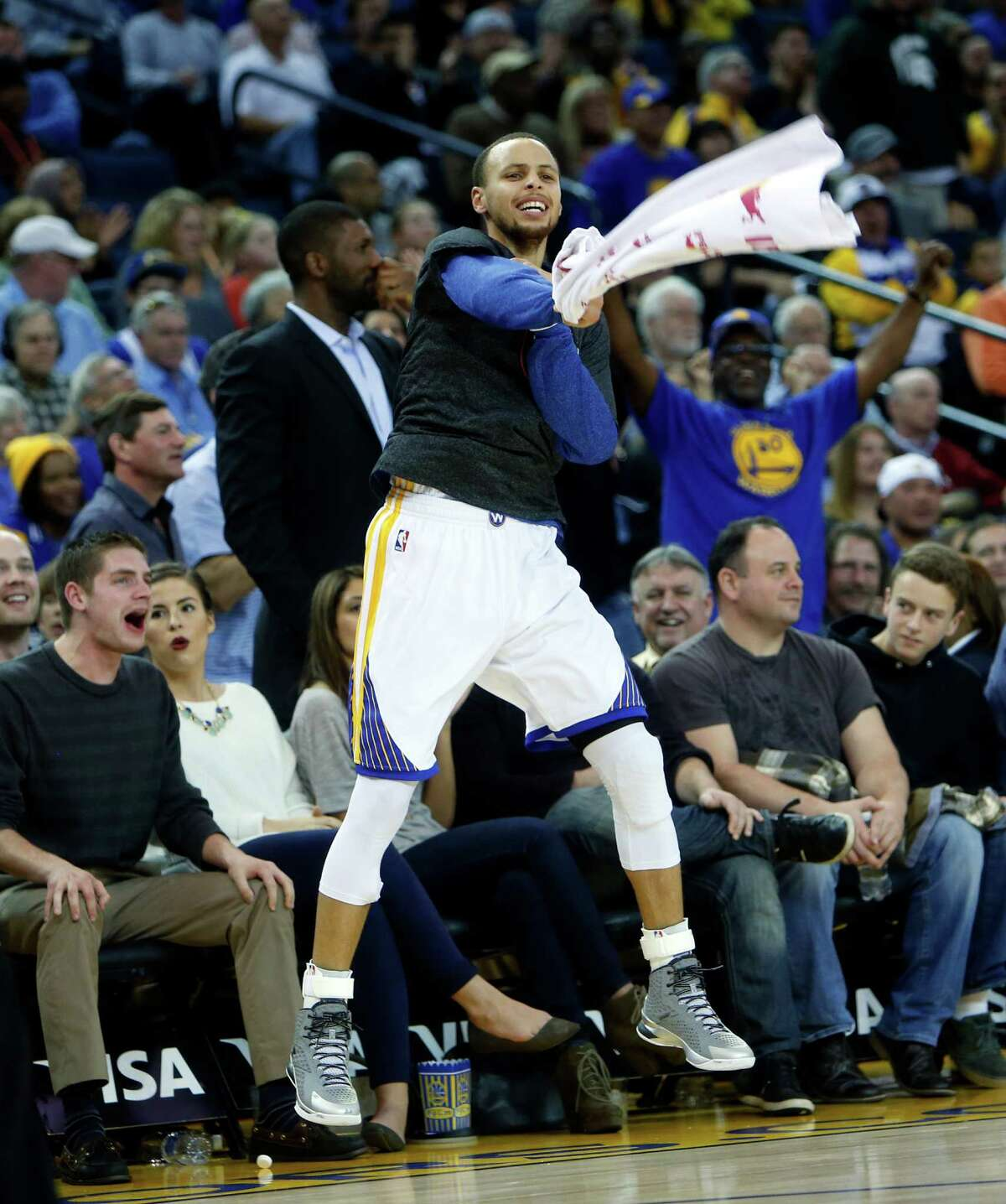 Golden State Warriors' Stephen Curry enjoys a block by rookie James Michael McAdoo in 4th quarter of Warriors' 122-79 win over the Denver Nuggets during NBA game at Oracle Arena in Oakland, Calif. on Monday, January 19, 2015.