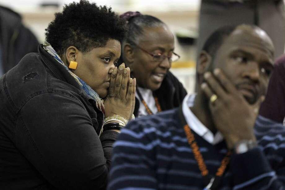 McClymonds High School teacher Valerie Trout (left) attends a meeting last week on struggling Oakland schools. Photo: Carlos Avila Gonzalez / The Chronicle / ONLINE_YES