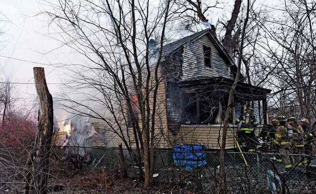 Fire consumes a home at 10 Grenada Terrace Dec. 18, 2014 in Watervliet, N.Y.  There were no injuries. (Skip Dickstein/Times Union archive) Photo: SKIP DICKSTEIN