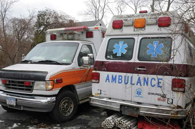 A couple of ambulances are seen on the property of Colonie EMS worker Dave Plouff whose house burned down Dec. 18, 2014 on Monday, Jan. 19, 2015 in Watervliet, N.Y. The community has since raised over $50,000 for Dave. He's hoping to rebuild the home in the same spot. (Lori Van Buren / Times Union) Photo: Lori Van Buren / 00030259A