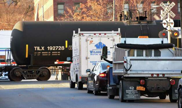 Traffic backs up on N. Ferry St. as a train moving oil tank cars passes Friday Nov. 21, 2014, in Albany, NY.  (John Carl D'Annibale / Times Union) Photo: John Carl D'Annibale