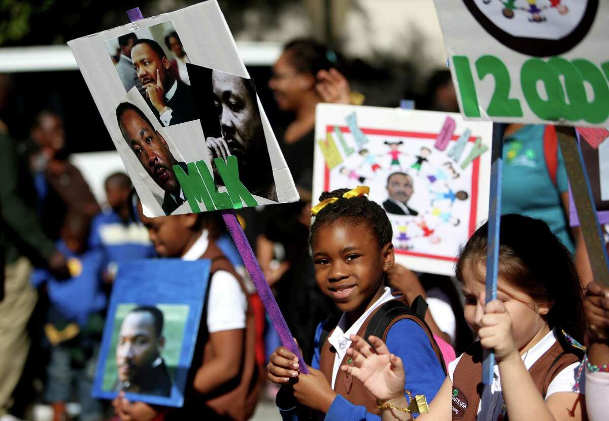 A Girl Scout Brownie troop marches in Houston's 2015 Original Martin Luther King Parade Monday, Jan. 19, 2015, in Houston, Texas.