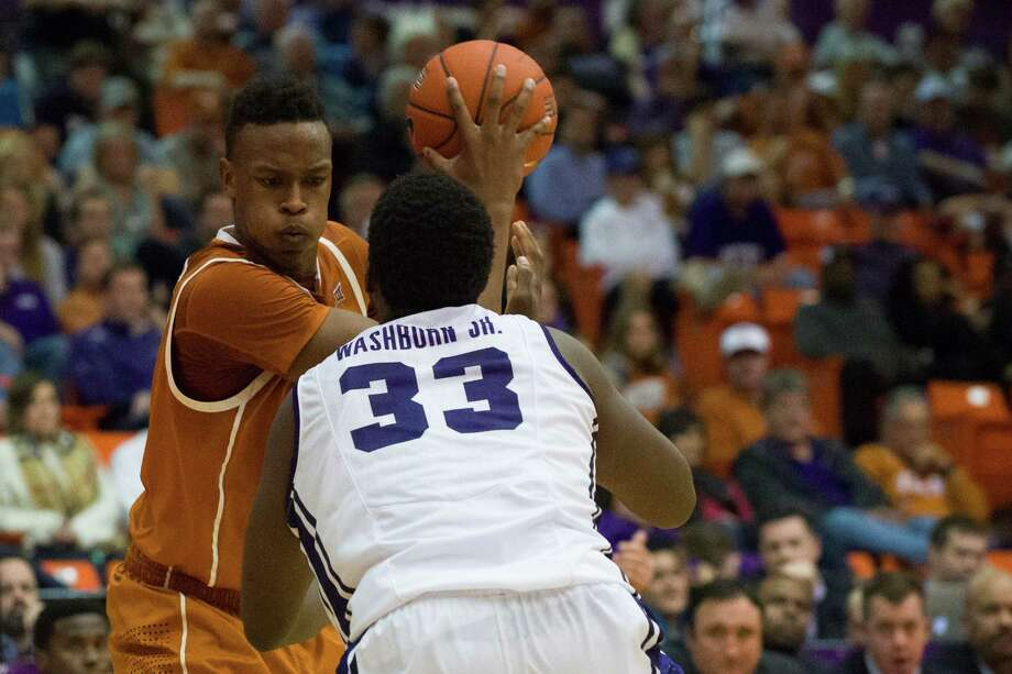 Texas' Myles Turner (left) drives to the basket against Chris Washburn Jr. of TCU. The 17th ranked Longhorns beat the Horned Frogs 66-48 in Fort Worth. Photo: Cooper Neill /Getty Images / 2015 Getty Images
