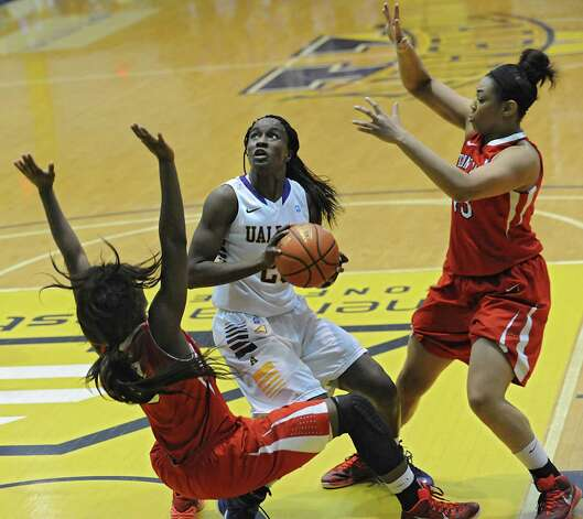 UAlbany's Shereesha Richards is fouled as she is guarded by Stony Brook's Jessica Ogunnorin, left, and Sabre Proctor during a basketball game at the SEFCU Arena on Monday, Jan. 19, 2015 in Albany, N.Y. (Lori Van Buren / Times Union) Photo: Lori Van Buren / 00030230A