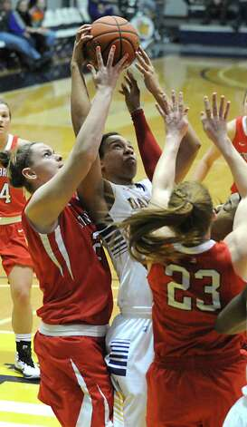 UAlbany's Tiana-Jo Carter comes down with a rebound during a basketball game against Stony Brook in the SEFCU Arena on Monday, Jan. 19, 2015 in Albany, N.Y.  (Lori Van Buren / Times Union) Photo: Lori Van Buren / 00030230A