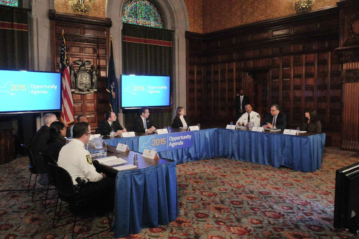 Governor Andrew Cuomo meets with members of the Commission on Youth, Public Safety and Justice to receive their report at the Capitol on Monday, Jan. 19, 2015, in Albany, N.Y. (Paul Buckowski / Times Union)