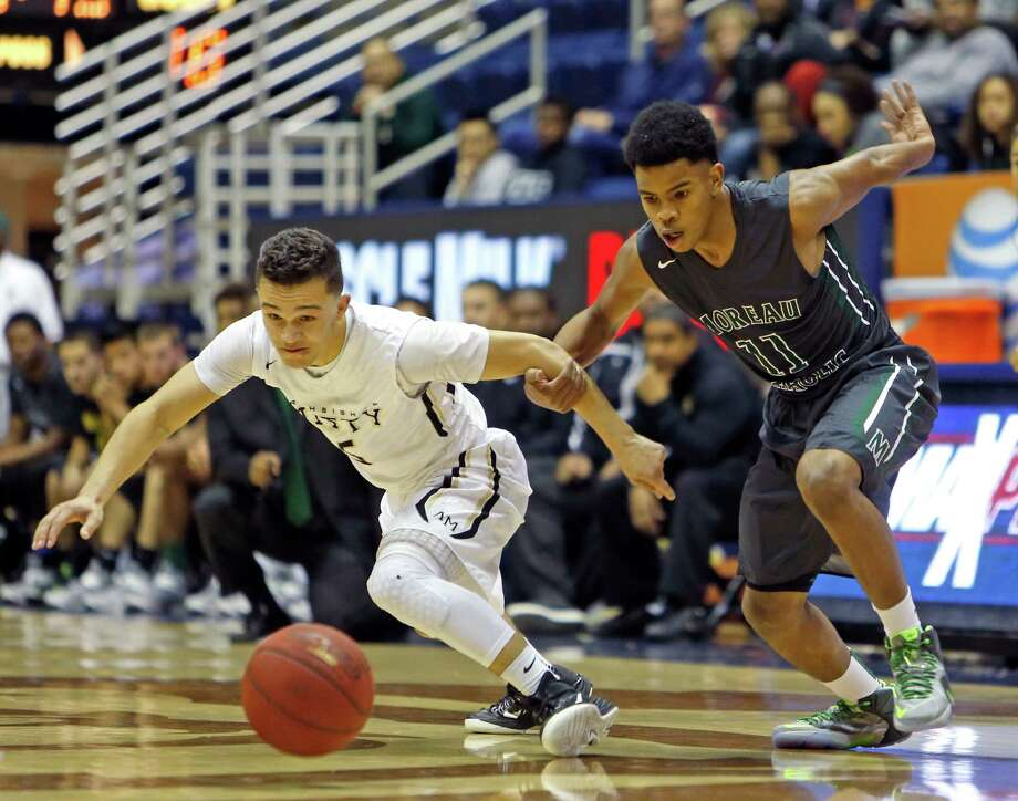 Archbishop Mitty's Sam Serra (left) and Moreau Catholic's Damari Milstead chase a loose ball in 1st quarter during MLK Classic at Haas Pavilion in Berkeley, Calif. on Monday, January 19, 2015. Photo: Scott Strazzante / The Chronicle / ONLINE_YES
