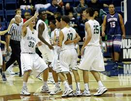 De La Salle players celebrate a big basket during Monday's play at Haas Pavilion, which will host the state finals.
