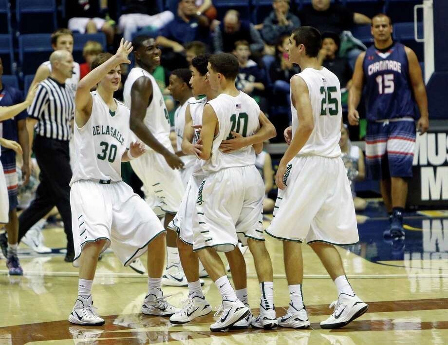 De La Salle players celebrate a big basket during Monday's play at Haas Pavilion, which will host the state finals. Photo: Scott Strazzante / The Chronicle / ONLINE_YES