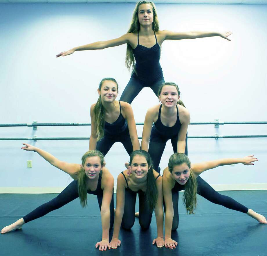 Studio D dancers strike a pose during preparations for their performance trip to New York City later this winter.  Courtesy of Studio D Photo: Contributed Photo / The News-Times Contributed