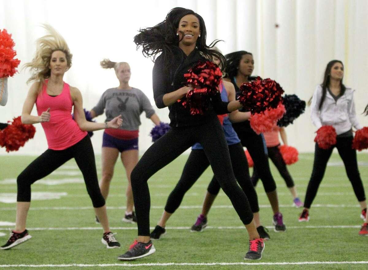 Texans cheerleader Lesha dances during Cheerba, a fitness workout by Texans cheerleading coach Alto Gary.